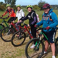 Kids practise balance in an after school mountain bike skills lesson