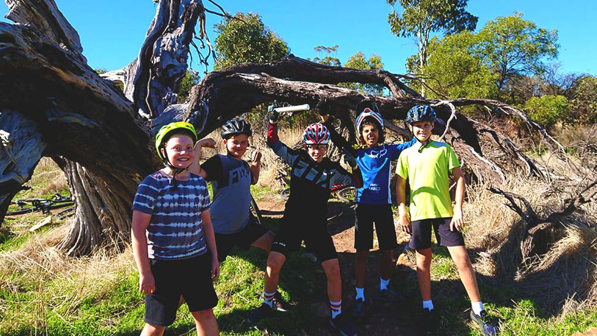 A group of young riders after finding a geocache during our school holiday activities