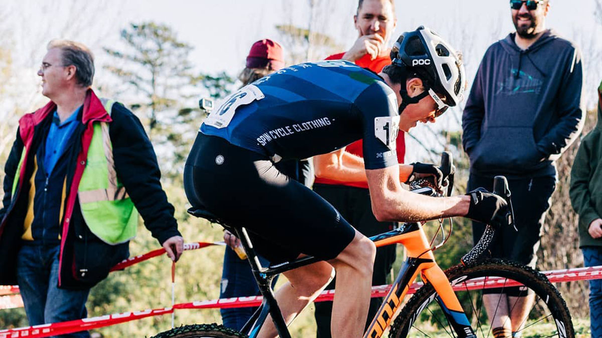 Griffin Knight on a climb in a cyclocross race