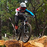 A rider demonstrates his drop off trail skills