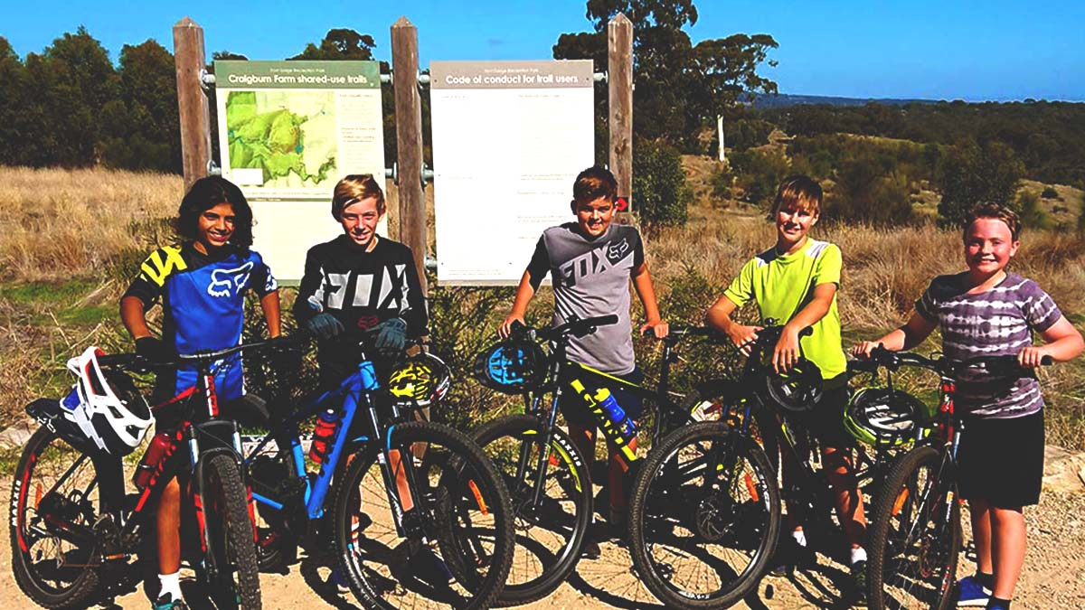 Mountain bikers in front of the Craigburn Farm trailhead