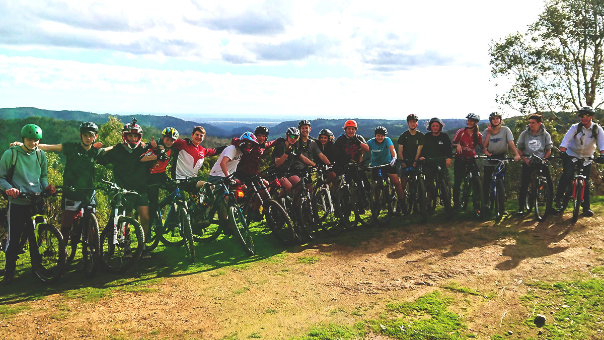 A group of students on a school outdoor education mountain bike camp