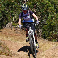 A woman riding her mountain bike on single track