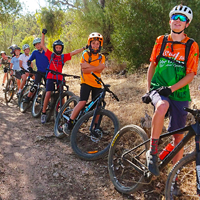 A group of young mountain bikers during a school skills program