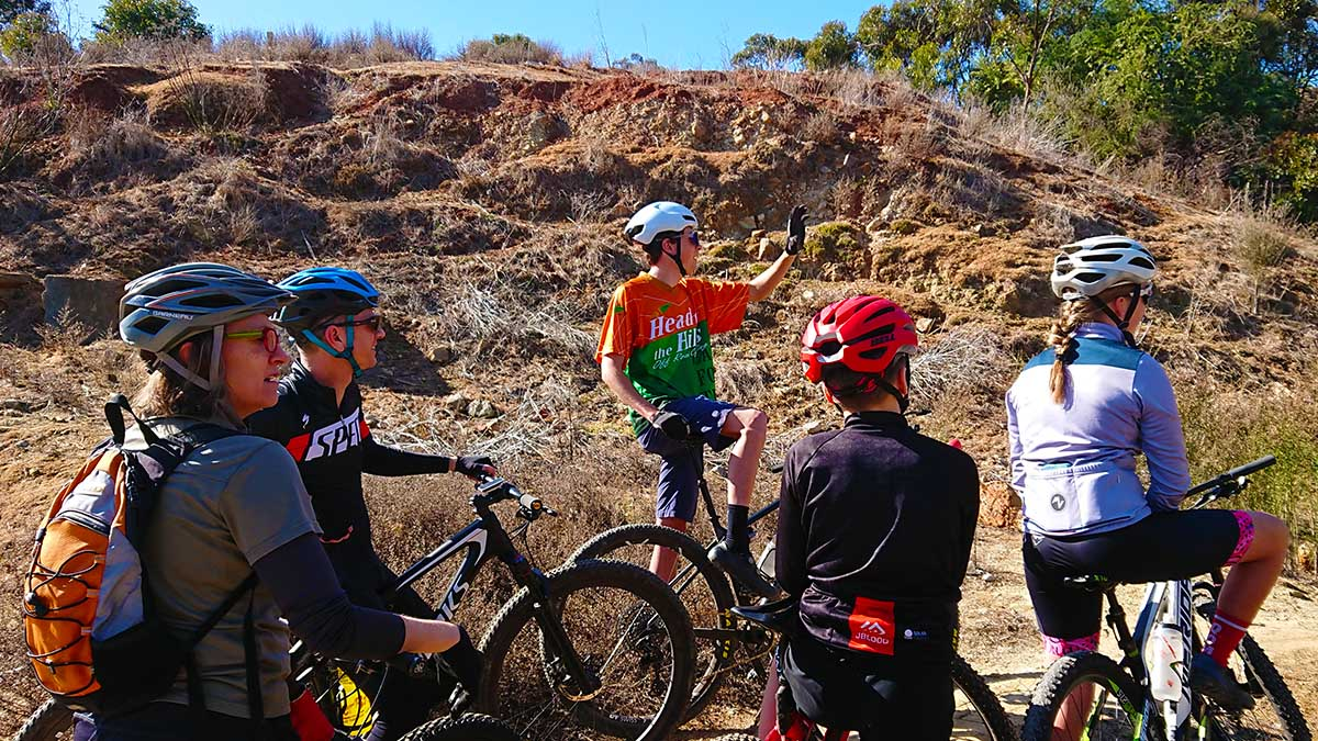 A group of mountain bikers in a coaching session